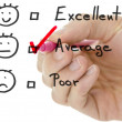 Stock Photo: Customer service evaluation form with tick on average