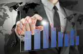 Business man pointing at interactive business graph — Stock Photo