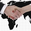 Handshake with map of the world in background — Stock Photo #25818571