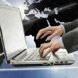 Business man using laptop in interactive space — Stockfoto