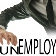 Stock Photo: Changing word Unemployed into Employed