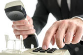 Businessman hand dialing a phone number — Stock Photo