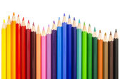 Colored pencils making a wave — Stock Photo