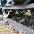 Closeup of old steam train on rails — Stock Photo