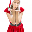 Woman in a Christmas dress blowing a kiss at you — Stock Photo #30256819