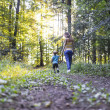 Young mother on a walk with her son — Stock Photo