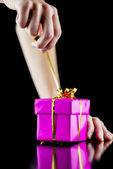 Opening a gift box — Stock Photo