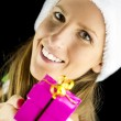 Miss Santa holding a christmas present — Stock Photo