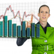 Foto Stock: Businesswompointing at interactive business graph