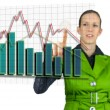 Businesswompointing at interactive business graph — Stock Photo #33887319