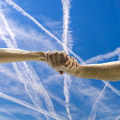 Handshake over beautiful sky — Stock Photo