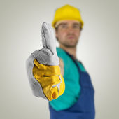 Construcion worker showing thumbs up sign — Stock Photo