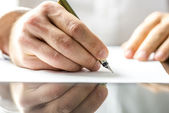 Man writing on a blank paper — Stock Photo