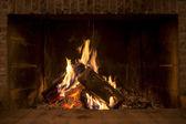 Fire in fireplace — Stok fotoğraf
