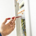 Electrician testing an electrical circuit board — Stock Photo #38306277