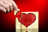Man completing a red romantic heart shape — Stock Photo