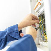 Electrician installing an electrical fuse box — Stock Photo