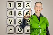Woman with a numeric keypad — Stock Photo
