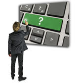 Man activating a Question mark on a keypad — Stock Photo