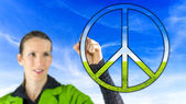 Woman with a peace sign — Stock Photo