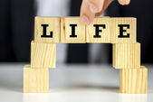Bridge of cubes with word life written on them — Stock Photo