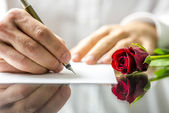 Romantic man writing a love letter — Stock Photo