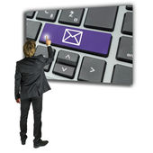 Businessman sending an email message — Stock Photo