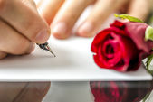 Man writing a letter to his sweetheart — Stock Photo
