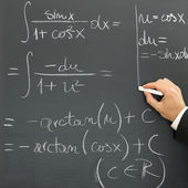 Businessman writing scientific formula — Stock Photo