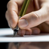 Man writing with a fountain pen — Stock Photo