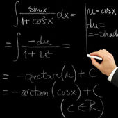 Hand writing with chalk a mathematical exercise — ストック写真