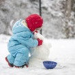 Young child building a snowman — Stock Photo #40103933
