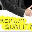 Businessman giving a thumbs up for Quality — Stock Photo #40609581