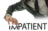 Businessman with the word Im-Patient — Stock Photo