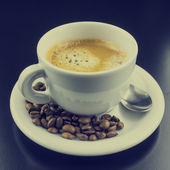 Cup of hot frothy espresso coffee — Stock Photo