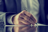 Man signing a document or writing correspondence — Stock Photo