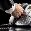 Stock Photo: Businessmmaking call on landline