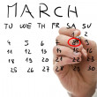 Male hand marking on calendar the date of March 8 — Stock Photo