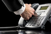 Businessman making a call on a landline — Stock Photo