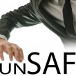 Stock Photo: Mreaching for text Unsafe - Safe