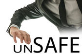 Man reaching for the text Unsafe - Safe — Stock Photo