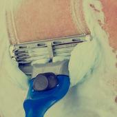 Man shaving using shaving cream or foam — Stock Photo