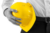 Man carrying a yellow hard hat — Stock Photo