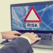 Laptop screen with a sign with the word - Risk — Stock Photo