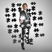 Businessman selecting a puzzle piece — Stock Photo