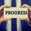 Two joined puzzle pieces with the word Progress — Stock Photo #45473295