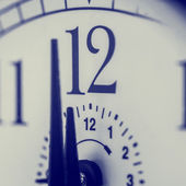 Clock about to strike 12 midnight or midday — Stock Photo