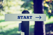 Oldr rustic signpost with the word Start — Stock Photo