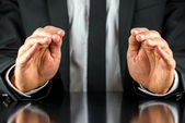 Businessman making a protective gesture — Foto de Stock