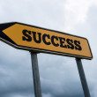 Signboard and arrow with the word - Success — Stock Photo #47311317
